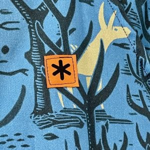 James Green Prints Donkey Woods Fabric Detail with The Stitch Society Logo