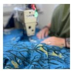 Image showing James Green Prints Donkey Woods being sewn at an industrial sewing machine with hands slightly out of focus