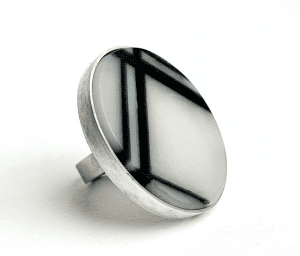 Image for the Pocket Book 10th July shows a silver ring with black and white enamel in a geometric pattern.