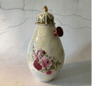 Pocket Book 10th July shows a floral vase with added metalwork